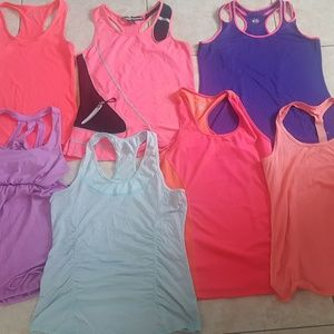 Women's lot of workout clothes.